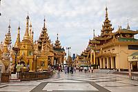 Myanmar, Burma.  Shwedagon Pagoda, Yangon, Rangoon.  Visitors Circumambulate the Stupa.