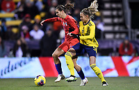 COLUMBUS, OH - NOVEMBER 07: Tobin Heath #17 of the United States and , Nathalie Bjorn #5 of Sweden battle during a game between Sweden and USWNT at MAPFRE Stadium on November 07, 2019 in Columbus, Ohio.