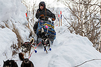 Mike Williams Jr. handles his sled on the last leg of the Happy River steps during the 2016 Iditarod Trail between the Finger Lake and Rainy Pass Checkpoints.  Alaska.  March 07, 2016.  <br /> <br /> Photo by Jeff Schultz (C) 2016 ALL RIGHTS RESERVED