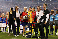 CHARLOTTE, NC - OCTOBER 3: Ali Krieger #11 of the United States poses with Kate Markgraf, Cindy Parlow Cone, Ashlyn Harris #18, and her family while being honored for playing 100 games for the national team during a game between Korea Republic and USWNT at Bank of America Stadium on October 3, 2019 in Charlotte, North Carolina.