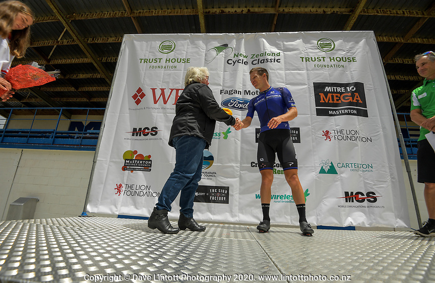 Aaron Gate is presented with the yellow jersey after stage two of the NZ Cycle Classic UCI Oceania Tour (Gladstone circuit) in Wairarapa, New Zealand on Thursday, 16 January 2020. Photo: Dave Lintott / lintottphoto.co.nz