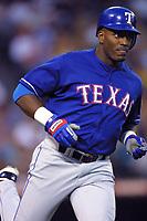Ruben Sierra of the Texas Rangers during a 2001 season MLB game at Angel Stadium in Anaheim, California. (Larry Goren/Four Seam Images)
