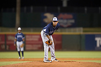 AZL Padres relief pitcher Jose Cabrera (12) looks to his catcher for the sign against the AZL Indians on August 30, 2017 at Goodyear Ball Park in Goodyear, Arizona. AZL Padres defeated the AZL Indians 7-6. (Zachary Lucy/Four Seam Images)