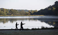 Jason Salgado (right) teaches Tia Chi - Qigong to Lamar Howard Tuesday Oct. 12, 2021 at Lake Atlanta in Rogers. Salgado who was teaching classes at the Rogers Activity Center till is closes down due to covid started doing the  classes on Tuesday and Thursday at 8:30am to 10am at the lake. For more information on his class you can go to https://www.ozarktaichi.com. Go to nwaonline.com/211013Daily/ to see more photos from around Northwest Arkansas. (NWA Democrat-Gazette/Spencer Tirey)