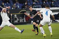 Leon Goretzka (Deutschland Germany) gegen Victor Palsson (Island Iceland) - 25.03.2021: WM-Qualifikationsspiel Deutschland gegen Island, Schauinsland Arena Duisburg