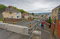 Pictured: The concrete barriers now installed at Waun Wen Road where cars were set alight in Mayhill, Swansea, Wales, UK. Wednesday 16 June 2021<br /> Re: Riot aftermath in the Mayhill area of Swansea, Wales, UK.Pictured: Wednesday 16 June 2021<br /> Re: Riot aftermath in the Mayhill area of Swansea, Wales, UK.