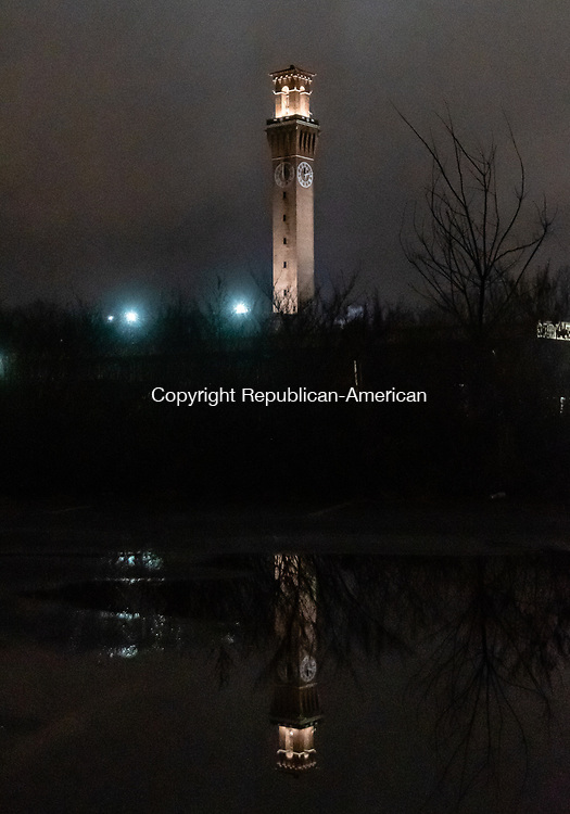 WATERBURY, CT. 04 January 2020-010420BS04 - The iconic Waterbury clocktower can bee seen in a reflection of a puddle of water on a dreary foggy evening on Saturday.  Bill Shettle Republican-American