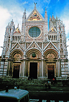Siena Cathedral, a medieval church in Siena,Italy. Originally designed and completed between 1215 and 1263. It has the form of a Latin cross with a slightly projecting transept, a dome and a bell tower. The dome rises from a hexagonal base with supporting columns. Giovanni Pisano was the sculptor.