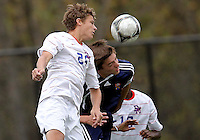 HYATTSVILLE, MD - OCTOBER 26, 2012:  Brendan Burke (25) of DeMatha Catholic High School goes for a header against Nelson Reed (11) of St. Albans during a match at Heurich Field in Hyattsville, MD. on October 26. DeMatha won 2-0.