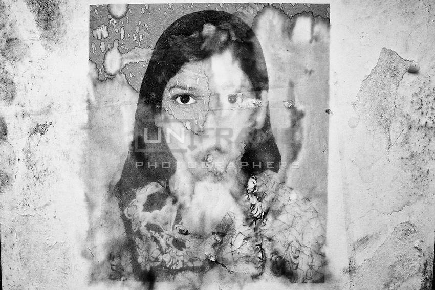 Photo of missing garments worker named  Ashma Aktar from Khulna at the Adhar Chandra school wall  posted by relatives. Savar, near Dhaka, Bangladesh