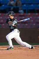 Dan Bowman #26 of the Coastal Carolina Chanticleers follows through on his swing versus the Wake Forest Demon Deacons at Wake Forest Baseball Park April 8, 2009 in Winston-Salem, North Carolina. (Photo by Brian Westerholt / Four Seam Images)