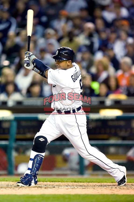 Detroit Tigers' Carlos Guillen (9) follows through on his swing versus the Los Angeles Angels at Comerica Park in Detroit, MI, Sunday, April 27, 2008.