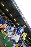 Chester City 1 Altrincham 3, 21/11/2009. Deva Stadium, Football Conference. The players making their way onto the pitch from the Vaughan Stand at the Deva Stadium, Chester, home of Chester City Football Club (in blue), before kick-off in the club's Blue Square Premier fixture against Cheshire rivals Altrincham. The visitors won by three goals to one. Chester were in administration at the start of the season and were penalised 25 points before the season began. Photo by Colin McPherson.