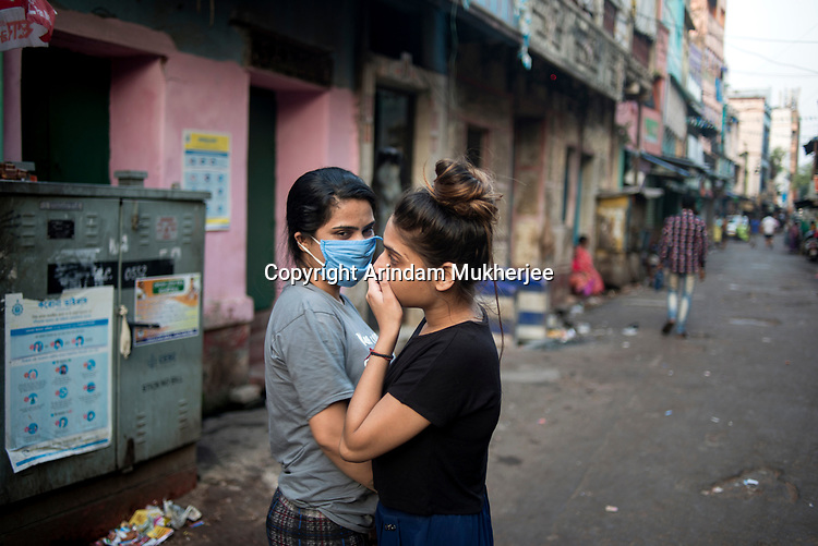 Sex workers loiter in the main road of Sonagachi in Kolkata during 21 days lock down in India due to covid 19 pandemic. Business are closed in all the red light areas in India during these 21 days. Sonagachi is the biggest red light area in Asia with 11000 active sex workers. Kolkata, West Bengal, India. Arindam Mukherjee.