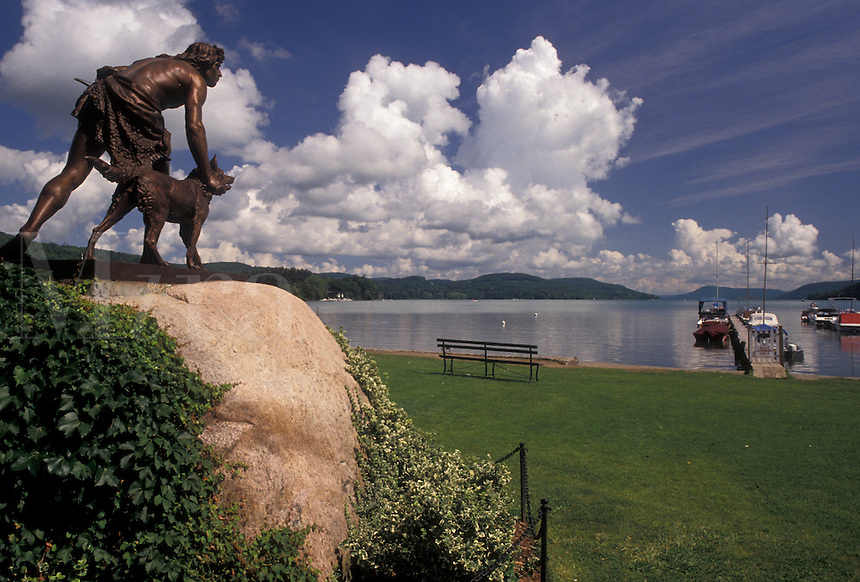 AJ4368, Cooperstown, lake, New York, Statue of a boy and his dog overlooking Otsego Lake in Cooperstown in the state of New York.