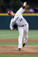 Starting pitcher Jordan Montgomery (34) of the South Carolina Gamecocks delivers a pitch in an NCAA Division I Baseball Regional Tournament game against the Campbell Camels on Friday, May 30, 2014, at Carolina Stadium in Columbia, South Carolina. South Carolina won, 5-2. (Tom Priddy/Four Seam Images)
