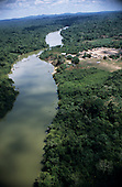 Bacaja village, Brazil. Aerial view of river through the rainforest and village; Xicrin Indian tribe, Amazon.