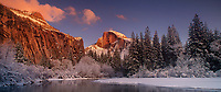 906500011 panoramic view of winter sunset light turning half dome a golden red with its reflection in the merced river with snow covering the fir trees and river banks in yosemite national park california