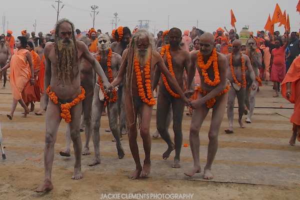 This older Naga sadhu with long grey dreadlocks is helped along in the parade to the sacred rivers for a holy bathe.
