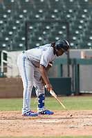Surprise Saguaros third baseman Vladimir Guerrero Jr. (27), of the Toronto Blue Jays organization, uses his bat to write in the dirt before an at bat during an Arizona Fall League game against the Salt River Rafters at Salt River Fields at Talking Stick on October 23, 2018 in Scottsdale, Arizona. Salt River defeated Surprise 7-5 . (Zachary Lucy/Four Seam Images)