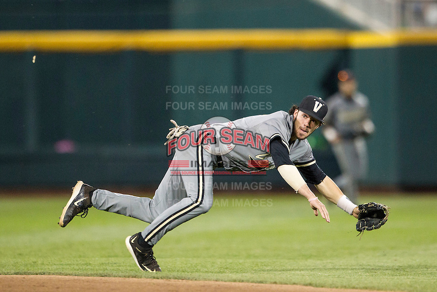Vanderbilt Commodores shortstop Dansby Swanson (7) dives to the ground during the NCAA College baseball World Series against the TCU Horned Frogs on June 16, 2015 at TD Ameritrade Park in Omaha, Nebraska. Vanderbilt defeated TCU 1-0. (Andrew Woolley/Four Seam Images)