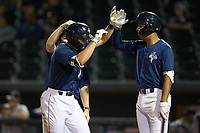 Brian Sharp (7) of the Columbia Fireflies is congratulated by teammate Mark Vientos (right) after hitting a 3-run home run against the Rome Braves at Segra Park on May 13, 2019 in Columbia, South Carolina. The Fireflies defeated the Braves 6-1 in game two of a doubleheader. (Brian Westerholt/Four Seam Images)