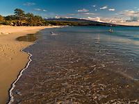 A couple enjoys the calm ocean at  Hapuna Beach Park, Big Island.