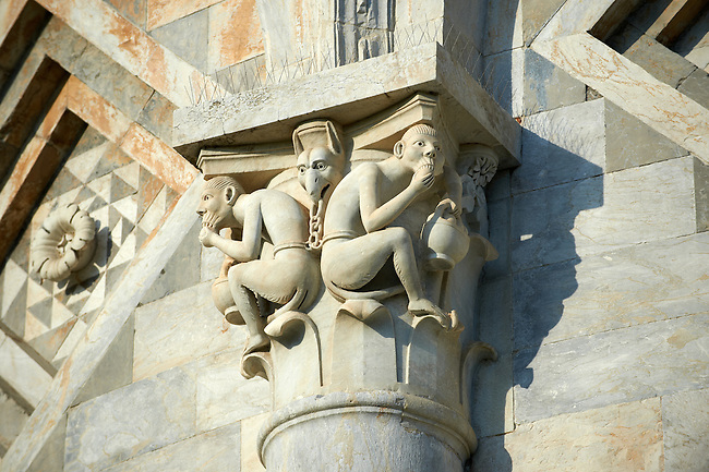 Grotesque Medieval pillar capital sculpture on the exterior of the Duomo Pisa