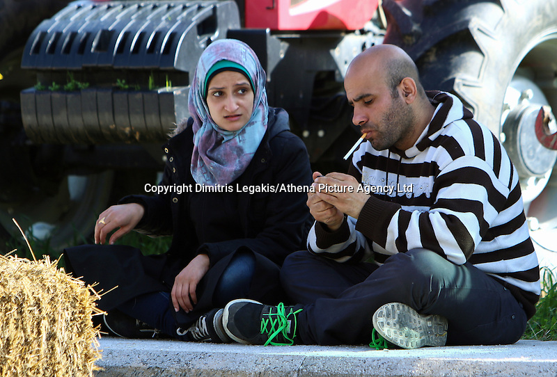 Pictured: Migrants at the road block Tuesday 23 February 2016<br /> Re: Migrants on their way back to Athens have been caught by the blocked off motorway at Tembi, where local farmers have closed off the road, protesting against pension and welfare reforms near Trikala, Greece.