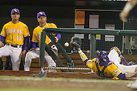 LSU Tigers catcher Kade Scivicque (22) falls to the ground as he misses a pop foul against the TCU Horned Frogs in Game 10 of the NCAA College World Series on June 18, 2015 at TD Ameritrade Park in Omaha, Nebraska. TCU defeated the Tigers 8-4, eliminating LSU from the tournament. (Andrew Woolley/Four Seam Images)
