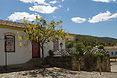 Goias Velho, Brazil. Well preserved colonial town; colonial architecture; single-storey house with yellow flowers on a tree.
