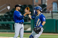 Rancho Cucamonga Quakes relief pitcher Jordan Sheffield (9) is congratulated by catcher Connor Wong (11) after a California League game against the Visalia Rawhide on April 8, 2019 in Visalia, California. Rancho Cucamonga defeated Visalia 4-1. (Zachary Lucy/Four Seam Images)