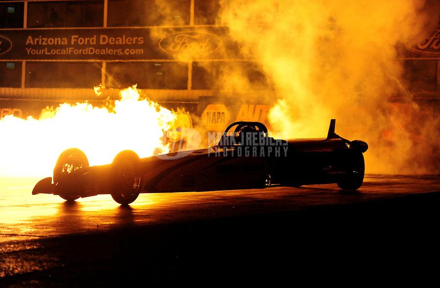 Oct. 14, 2011; Chandler, AZ, USA; NHRA jet dragster driver Elaine Watson during qualifying for the Arizona Nationals at Firebird International Raceway. Mandatory Credit: Mark J. Rebilas-