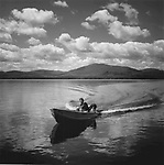 Scan of vintage print. Tolston in runabout with dog Boo. 1996. Moosehead Lake, ME. Negative file#96-210 B#7
