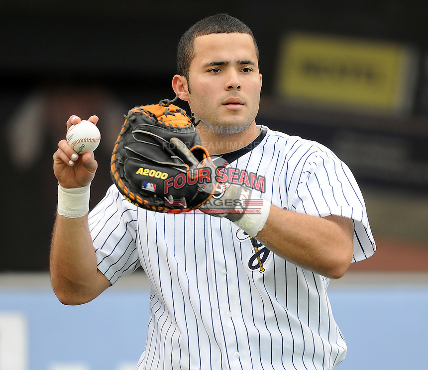 Catcher Jesus Montero (21) of the Scranton/Wilkes-Barre Yankees, International League affiliate of the New York Yankees, in a game against the Norfolk Tides on June 20, 2011, at PNC Park in Moosic, Pa. Montero is ranked the No. 1 New York Yankees' prospect for 2011 by Baseball America. (Tom Priddy/Four Seam Images).