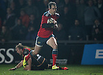 Outside centre Andrew Smith of Munster Rugby leaves Inside centre Ashley Smith of Newport Gwent Dragons on the floor as he runs forwards to score a try for Munster<br /> <br /> Guiness Pro 12<br /> Newport Gwent Dragons v Munster Rugby<br /> Rodney Parade<br /> 21.11.14<br /> ©Steve Pope-SPORTINGWALES