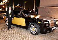 Photo: Richard Lane/Richard Lane Photography. London Wasps in Abu Dhabi for their LV= Cup game against Harlequins on 30st January 2011. 29/01/2011. Wasps' Steve Hayes with a black and gold Rolls Royce at the Emirates Palace Hotel.