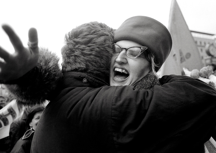 © John Angerson <br /> Fall of Berlin Wall - 1989<br /> November 1989. Berlin. Germany. <br /> Fellow East and West Berliners embrace next to the Berlin Wall. This was a pivotal event in world history with the ending of the Iron Curtain and the start of the collapse of communism in Eastern and Central Europe and in turn saw the reunification of Germany.