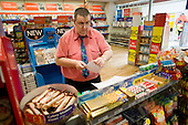 A Job Seekers Allowance claimant on a compulsory four week unpaid work placement in a branch of WH Smith in Middleton, Rochdale, part of a Mandatory Work Related Activity welfare-to-work programme.