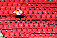 A steward sits in the main stand looking on during Charlton Athletic vs Wigan Athletic, Sky Bet EFL Championship Football at The Valley on 18th July 2020