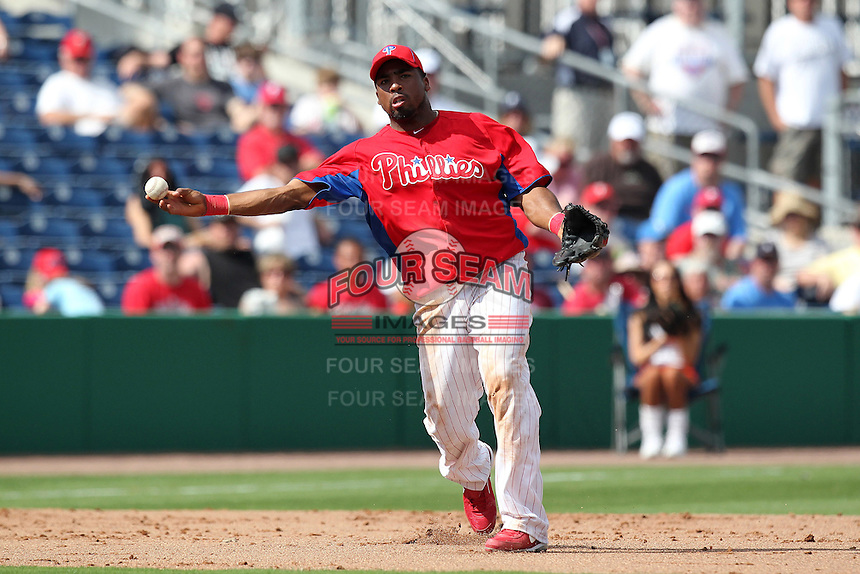 Philadelphia Phillies third baseman Hector Luna #29 throws to first during a scrimmage against the Florida State Seminoles at Brighthouse Field on February 29, 2012 in Clearwater, Florida.  Philadelphia defeated Florida State 6-1.  (Mike Janes/Four Seam Images)