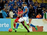 BOGOTA - COLOMBIA - 20 – 05 - 2017: Andres Cadavid (Der.) jugador de Millonarios disputa el balón con Uvaldo Luna (Izq.) jugador de Patriotas F.C., durante partido de la fecha 19 entre Millonarios y por la Liga Aguila I-2017, jugado en el estadio Nemesio Camacho El Campin de la ciudad de Bogota. / Andres Cadavid (R) player of Millonarios vies for the ball with Uvaldo Luna (L) player of Patriotas F.C., during a match of the date 19th between Millonarios and Patriotas F.C., for the Liga Aguila I-2017 played at the Nemesio Camacho El Campin Stadium in Bogota city, Photo: VizzorImage / Luis Ramirez / Staff.