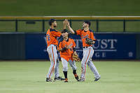 AZL Giants outfielders Aaron Bond (38), Ismael Munguia (29), and Nick Hill (22) celebrate after a win against the AZL Cubs on September 6, 2017 at Sloan Park in Mesa, Arizona. AZL Giants defeated the AZL Cubs 6-5 to even up the Arizona League Championship Series at one game a piece. (Zachary Lucy/Four Seam Images)