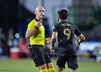 LAKE BUENA VISTA, FL - JULY 18: The referee Allen Chapman tells Diego Rossi #9 of LAFC to get away from the keeper during a game between Los Angeles Galaxy and Los Angeles FC at ESPN Wide World of Sports on July 18, 2020 in Lake Buena Vista, Florida.
