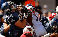 Sep 25, 2005; Seattle, WA, USA; Seattle Seahawks defensive end #98 Grant Wistrom battles with Arizona Cardinals guard #74 Reggie Wells in the first quarter at Qwest Field. Mandatory Credit: Photo By Mark J. Rebilas