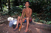 Laos, Luang Namtha forst..Hmong man smoking traditional bong and disfigured by bear mauling...Photo by Kees Metselaar, 2003