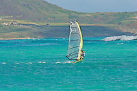 Windsurfer takes advantage of windy conditions at Kailua beach on the island of Oahu, Hawaii.