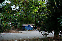 Homeless refugees and migrants sleeping rough in Alexandra Park Athens. 12-6-12