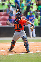 Greeneville Astros catcher Gabriel Bracamonte (18) makes a throw to first base against the Kingsport Mets at Hunter Wright Stadium on July 7, 2015 in Kingsport, Tennessee.  The Mets defeated the Astros 6-4. (Brian Westerholt/Four Seam Images)