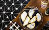 Mosaic oyster tray in Emperador Dark, Calacatta, 24K Gold glass, and Deep Ultra Marine Serenity glass.
